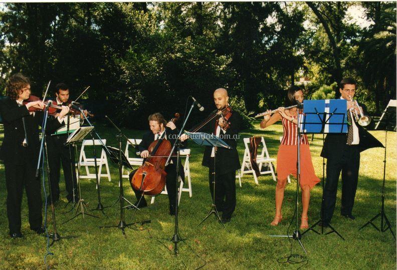 Cuerdas + flauta + trompeta