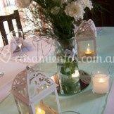 Centro de mesa flores faroles