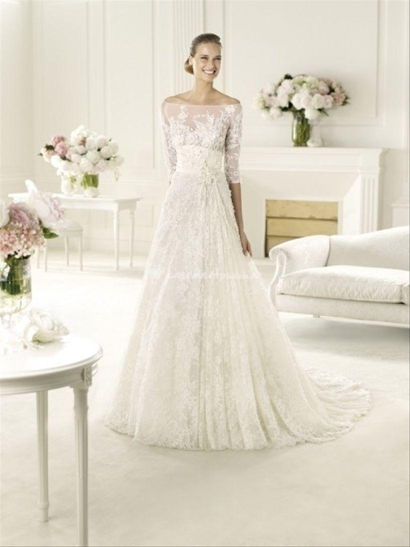 Vestido de novia con manga tres cuartos