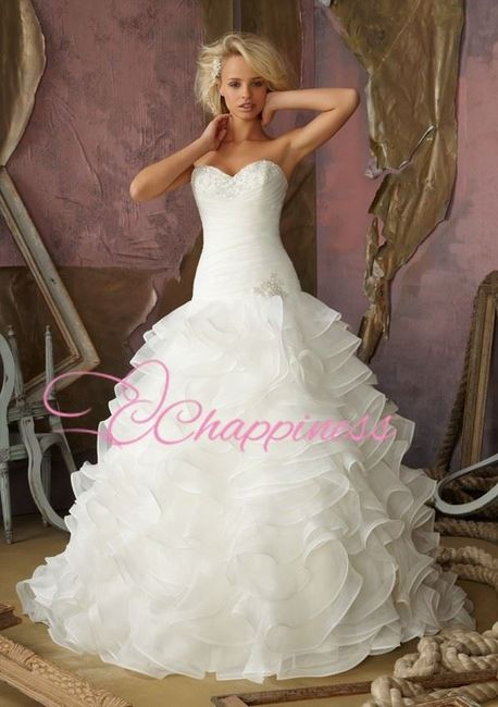 se usan los vestidos de novia con vuelos?